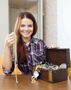 woman chooses jewelry in  chest