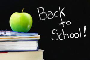 Back to School written on blackboard, books and apple in front